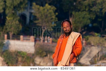 Indian Sadhu On The Beach Near River Ganga