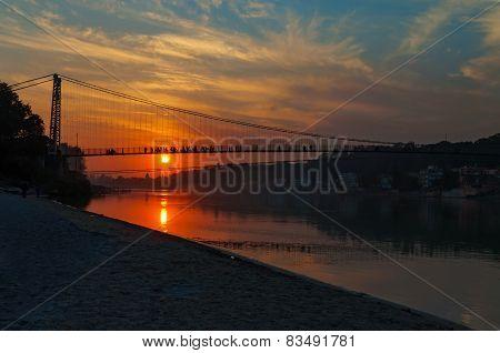 View Of River Ganga And Ram Jhula Bridge At Sunset