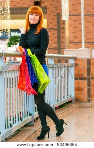 Nice Girl With Shopping Bags Indoors
