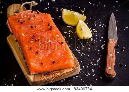 Fresh Salmon Fillet With Lemon, Pepper And Sea Salt