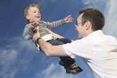 foto of time flies  - Dad and son playing at the day time - JPG