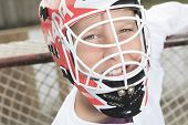 stock photo of hockey arena  - A young teen hockey goaler outside in the arena - JPG