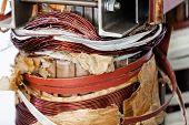 foto of transformer  - details of broken high voltage power transformer at repair shop - JPG