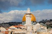 picture of aqsa  - Minaret and Dome of the Rock in Jerusalem against dramatic cloudy sky - JPG