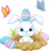 stock photo of rabbit hole  - Vector illustration of cute Easter bunny peeking out of a hole - JPG