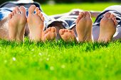 stock photo of relaxing  - Family with small children relaxing on the grass - JPG