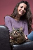 foto of cuddle  - Young smiling woman cuddling her long hair beautiful cat - JPG