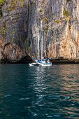 stock photo of koh phi-phi  - a luxurious catamaran floating on the clear waters of phi phi island Thailand - JPG