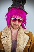 foto of lunate  - Pink haired bearded cool bum lunatic man - JPG