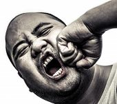 stock photo of insane  - I bald head man got punch in the face in isolated background - JPG