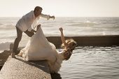 picture of tease  - Young beautiful bridal couple having fun together at the beach - JPG