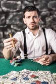 stock photo of gangster  - View of a gangster man is smoking a cuban cigar while he