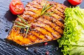 foto of  breasts  - Steak chicken breast olive oil cherry tomatoes pepper and rosemary herbs - JPG