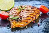 pic of  breasts  - Steak chicken breast olive oil cherry tomatoes pepper and rosemary herbs - JPG