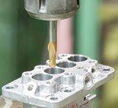 picture of machine  - operator machining aluminium automotive parts by high precision machining center - JPG