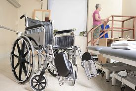 image of physiotherapist  - Elderly lady with her physiotherapists in a hospital - JPG