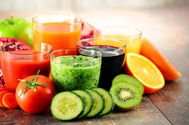 image of cucumbers  - Glasses of fresh organic vegetable and fruit juices. Detox diet.