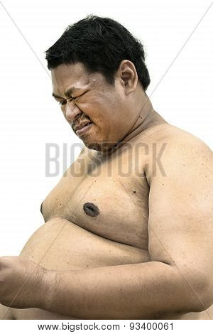 Fat Naked Upper Body And Belly Stomach Of An Asian African Man Showing Pain Expression On His Face I