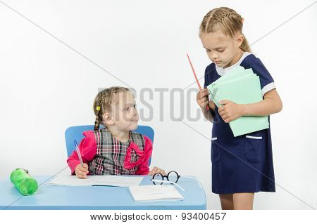 Teacher Seeks Pupil Notebook Pile Of Notebooks
