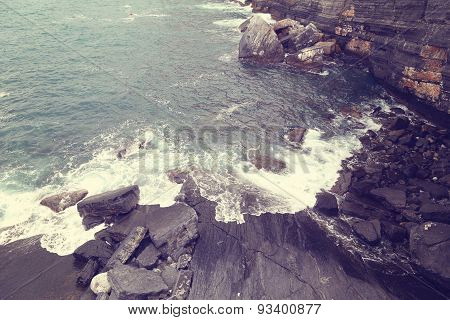 Waves hitting rocky shore