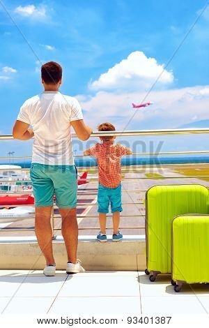 Family Watching The Plane Takes Off, While Waiting For Boarding In International Airport