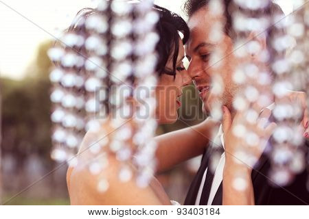 Happy bridal couple kissing