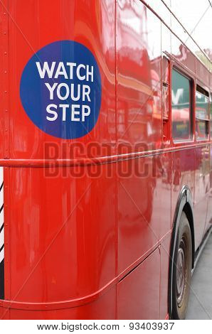Watch your step sign on rear the rear of a London bus.
