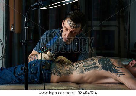 Tattoo Artist Creates A Design Of Tattoo