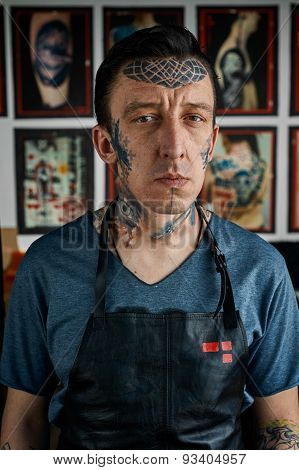 Tattoo Master In Black Leather Apron In Studio