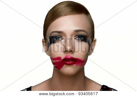 Beauty Sad Female Model With Smeared Mascara And Red Lipstick.