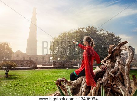 Woman Pointing At Qutub Minar