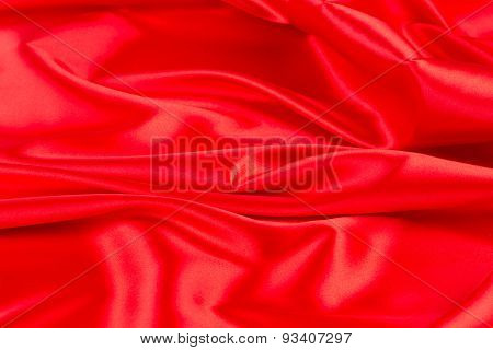 Red silk drapery. Close up.