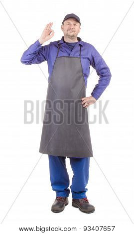 Worker in black apron with ok sign.