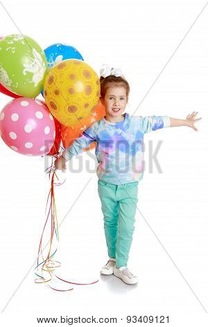 little girl with bouncy balls in his hand
