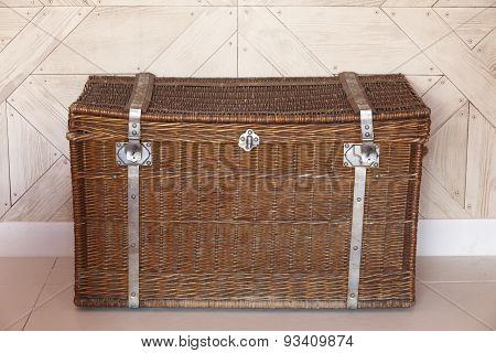Wicker Chest With Locks In A Room With Wooden Walls