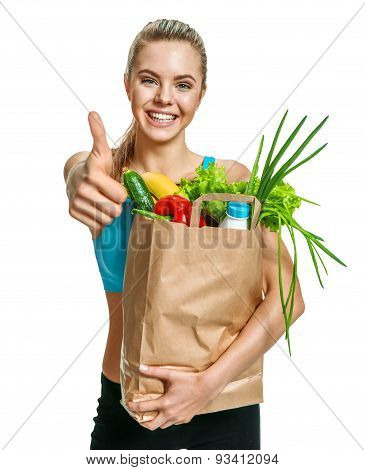 Beautiful Athletic Woman Gesturing Thumb Up With Grocery Bag Full Of Healthy Fruits And Vegetables