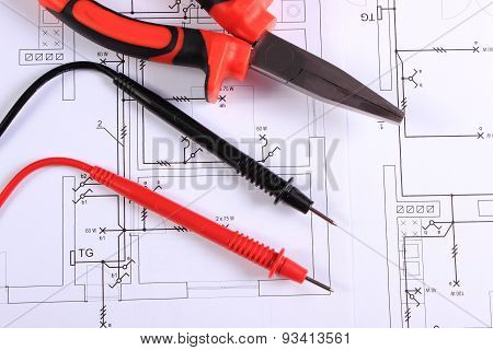 Cables Of Multimeter And Work Tool On Construction Drawing