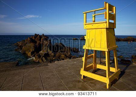 Yellow Lifeguard Chair Cabin  In Spain Rock Stone Sky Cloud B