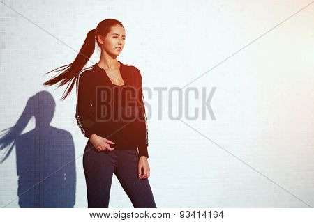 Portrait of an attractive and sporty young woman against a white background with dynamic flying hair