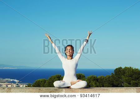 Young woman seeking enlightenment through meditation relaxed girl performing yoga near the ocean