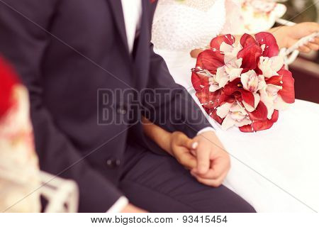 Bride And Groom Holding Hands. Bride Holding Calla Lillies Bouquet