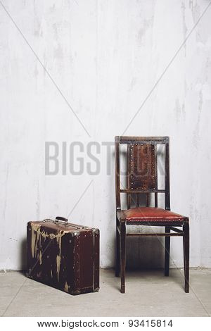 old suitcase and the chair