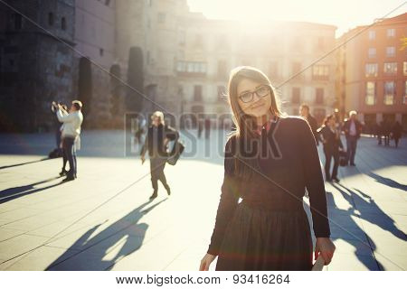 Portrait of happy smiling woman standing on the square on sunny summer or spring day
