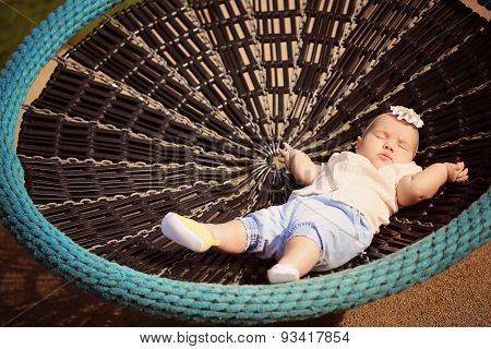 Beautiful Baby Girl Sleeping In A Bouncer