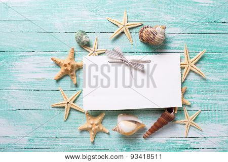 Emptytag and marine items on wooden background