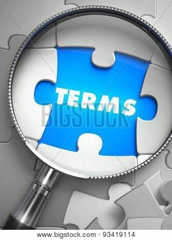 Terms - Missing Puzzle Piece through Magnifier.
