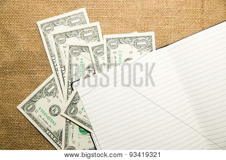 Opened Notebook And Money On The Old Tissue