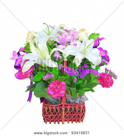 White Lily Flower Bouquet Decorated With Tropical Orchid And Green Leaves In Rattan Bucket Isolated