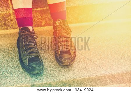 Young Punk Rock Woman With Weathered Sneakers