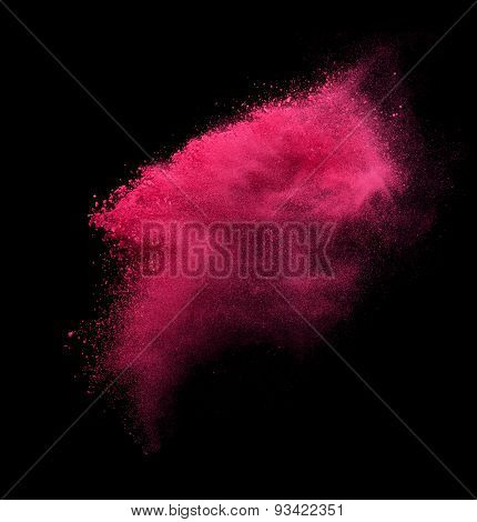 Red powder explosion isolated on black
